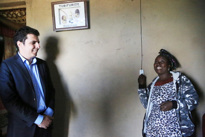 CEO with on of the family member donates solar power