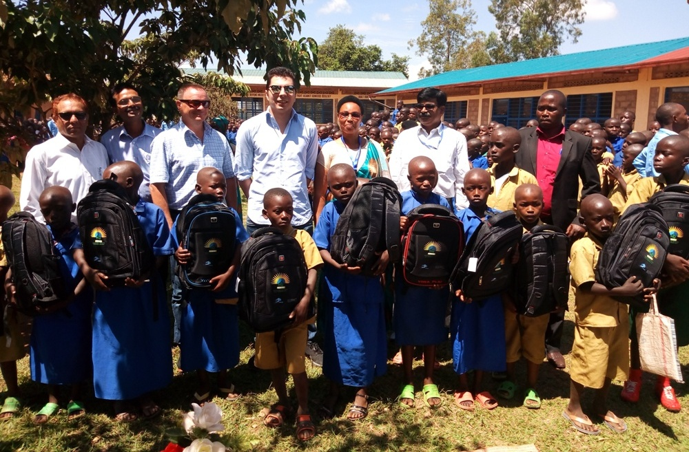 The HQ Power team with some of the pupils who received the scholastic materials.